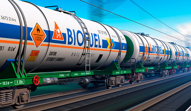 Fuel, oil and gas industry, ecology protection technology, logistics, cargo shipping and freight railroad transportation business concept: fast train with tankcars with biofuel with motion blur effect